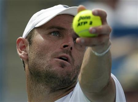 Mardy Fish of the United States, serves to Andy Murray of Britain, during their semifinal round match of the 2011 Cincinnati Open tennis tournament in Cincinnati,