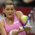 Radwanska of Poland returns the ball to Kirilenko of Russia during their Kremlin Cup tennis match in Moscow