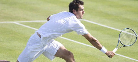 Croatia's Marin Cilic hits a return agai