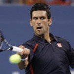Novak Djokovic of Serbia returns a shot to Paolo Lorenzi of Italy during their match at the US Open
