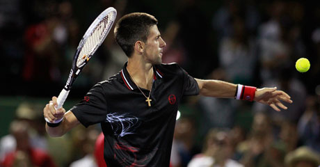 Serbia's Novak Djokovic hits a ball to the crowd after defeating Marcos Baghdatis of Cyprus during the Sony Ericsson Open tennis tournament in Key Biscayne