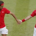 Switzerland's Federer and Wawrinka celebrate point against Japan's Soeda and Nishikori in their men's doubles tennis match at the All England Lawn Tennis Club during the London 2012 Olympics Games