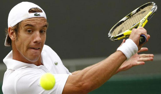 Gasquet of France returns the ball to Fish of the U.S. during their match at the Wimbledon tennis championships in London