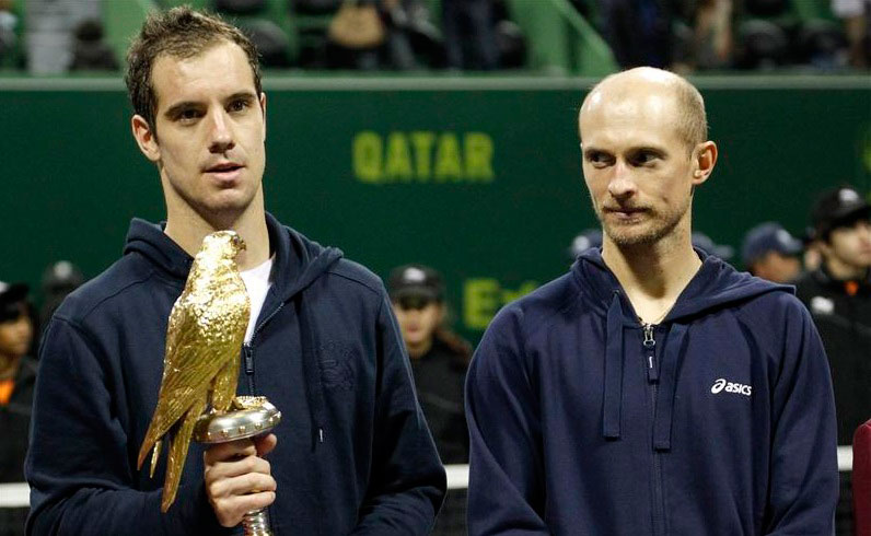 France's Richard Gasquet holds his trophy after he won the final against Nikolay Davydenko of Russia at the Qatar Open in Doha