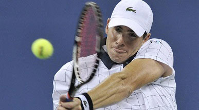 John Isner of the U.S. hits a return to Philipp Kohlschreiber of Germany during their match at the US Open