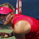 Kerber of Germany hits a shot to Hlavackova of the Czech Republic during their third round match in the 2012 Cincinnati Open tennis tournament in Cincinnati