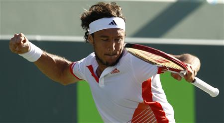 Monaco celebrates at the Sony Ericsson Open tennis tournament in Key Biscayne