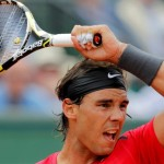Nadal of Spain returns the ball to Istomin of Uzbekistan during the French Open tennis tournament at the Roland Garros stadium in Paris