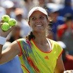 Robson of Britain prepares to hit balls to fans after defeating Li of China during their women's singles match at the U.S. Open tennis tournament in New York